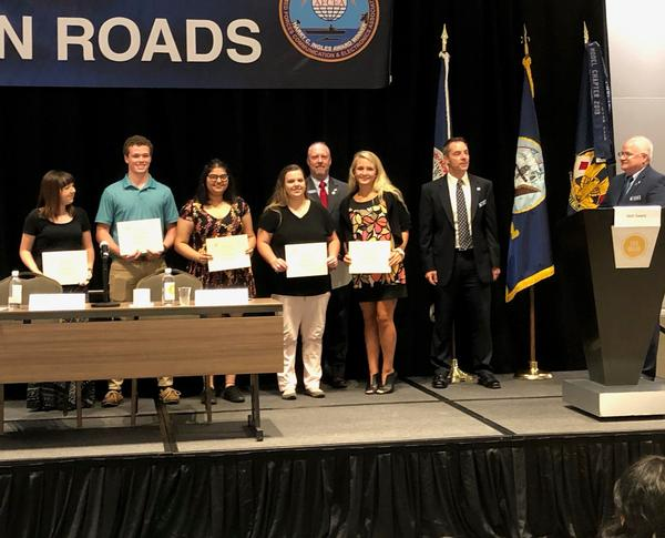 Awardees receive their AFCEA 2019 STEM Scholarship at the August event.