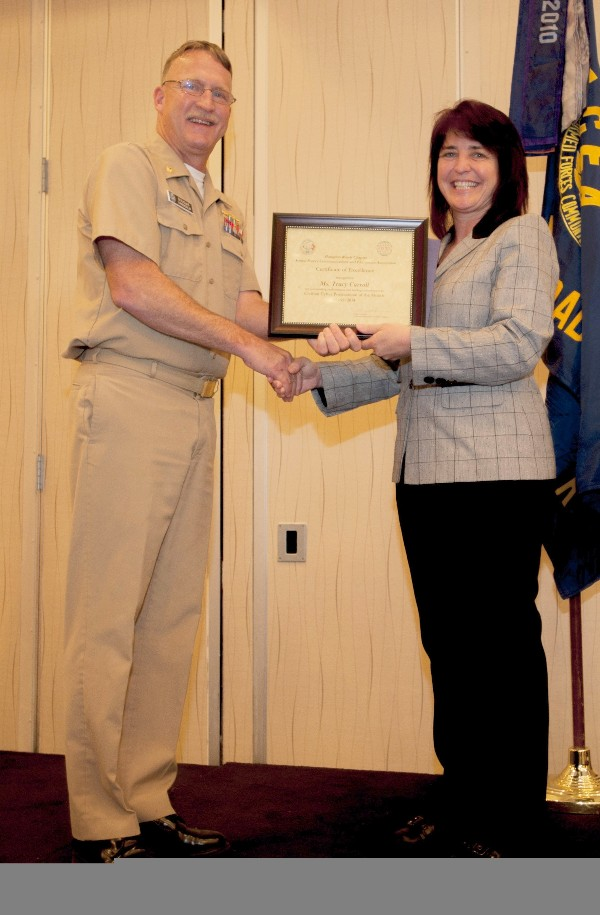 Lt. Cmdr. Doug Vanderlip, USN, chapter president, presents Carroll with the Civilian Cyber Professional of the Month award for March.