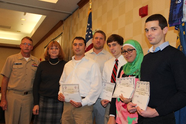 In November, Cmdr. Vanderlip (l) and Mary Yager (2nd from l), chapter vice president for education, present recognize Old Dominion University Student Chapter scholarship winners (3rd from left to right) Philip Irvine, Michael Thompson, Max Hall, Sawson Abutabenjah and Colin Dalton.