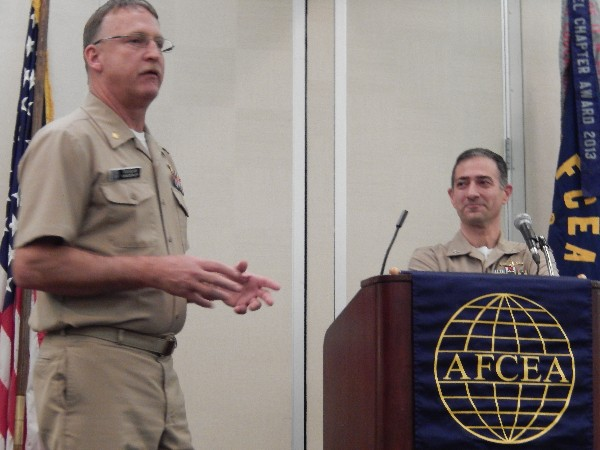 Cmdr. Vanderlip (l) introduces guest speaker Capt. Guzzo in December.