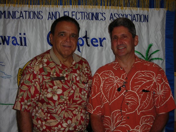 Together at the August luncheon are Cory Lindo (l), chapter president, and guest speaker Dr. David Lassner, vice president for information technology and chief information officer as well as acting interim president for the University of Hawaii.