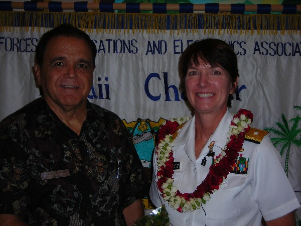 Cory Lindo, chapter president, thanks Rear Adm. Nancy A. Norton, USN, U.S. Pacific Command J-6, following her speech at the September meeting.
