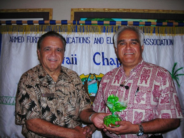 Cory Lindo, chapter president (l), thanks Sanjeev