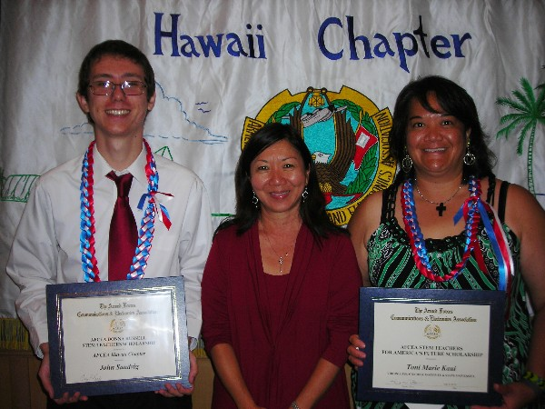 Cathy Burtless, chairperson of the AFCEA Hawaii Educational Foundation (c) is with scholarship winners John Sandvig, University of Hawaii at Manoa, and Toni Marie Kaui, Ph.D. candidate, in July.