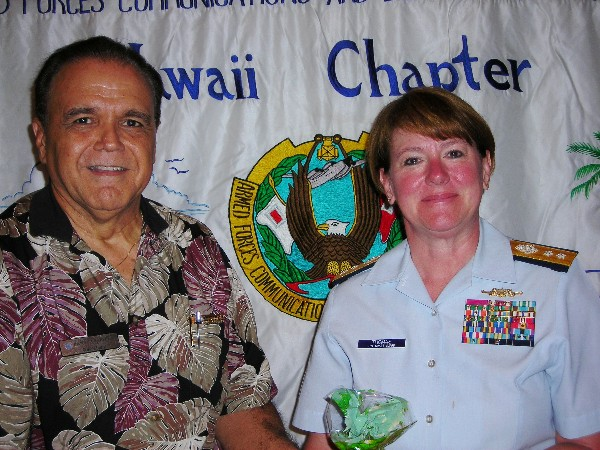 Cory Lindo, chapter president, thanks speaker Rear Adm. Cari B. Thomas, USCG, commander, Fourteenth Coast Guard District, following her presentation at the August meeting.