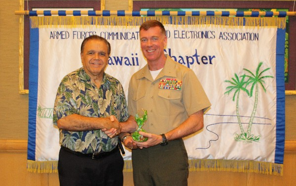 The chapter's chair of the board of directors, Cory Lindo, thanks May luncheon speaker Col. Jeff Davis, USMC, chief of staff, U.S. Marine Corps Forces, Pacific (MARFORPAC).