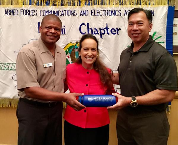 Guest speaker Anabel Chotzen (c) is presented a small token of appreciation by Executive Vice President Barry Fong (r) and Dee Smith, programs vice president, at the chapter meeting in June.