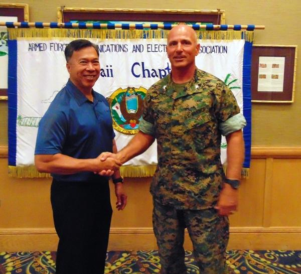 Attending the luncheon in July are Chapter Executive Vice President Barry Fong (l) and guest speaker Col. Joseph Matos, USMC, senior information technology officer, U.S. Marine Corps Forces Pacific.