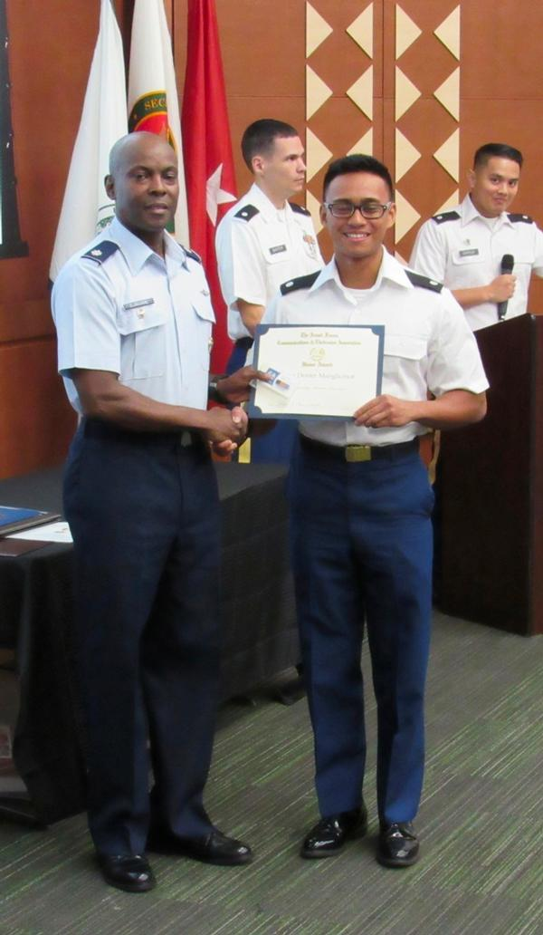 Chapter President Lt. Col. Callistus Elbourne, USAF (l), presents an AFCEA Honor Award to Cadet Dexter Manglicmot, Army ROTC, during a May ceremony at the University of Hawaii.