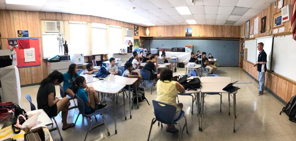Bob Monroe, ISECOM, teaches students at Saint Louis School, Honolulu, Hawaii, about cyber awareness and good hygiene at the July event.