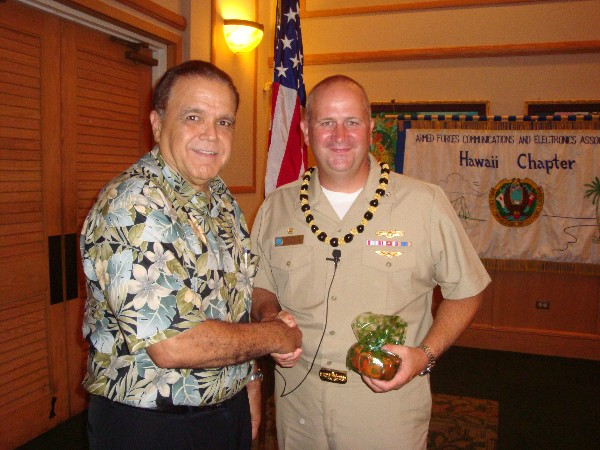 Cory Lindo (l), chapter vice president, thanks the guest speaker Capt. John MacMichael, USN, commanding officer of Naval Computer and Telecommunications Area Master Station Pacific, following his speech at the September luncheon.