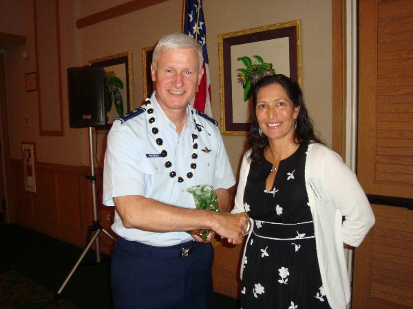 Maj. Gen. Norman J. Brozenick Jr., USAF, commander, Special Operations Command Pacific, U.S. Pacific Command, receives a thank you from Cynthia Pacheco, chapter president, at the October luncheon.