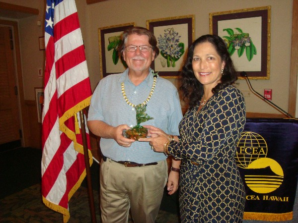 Cynthia Pacheco, chapter president, thanks the guest speaker for March, Peter Colvin, director of program development and outreach for the Maui High Performance Computing Center.