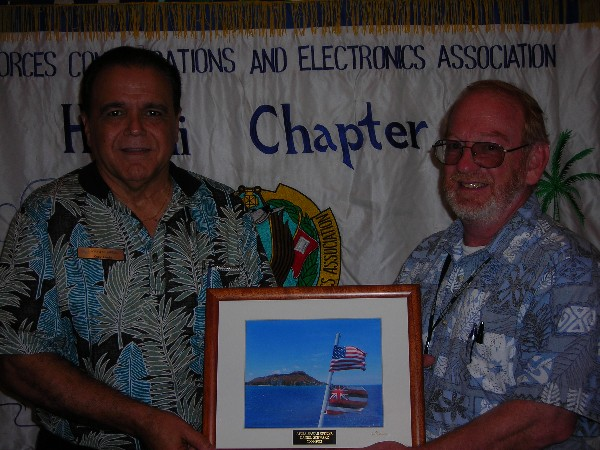 Daniel Schwarz (r), CACI International, receives a token of appreciation in January from Lindo recognizing his work as chapter vice president of finance from 2008-2012.