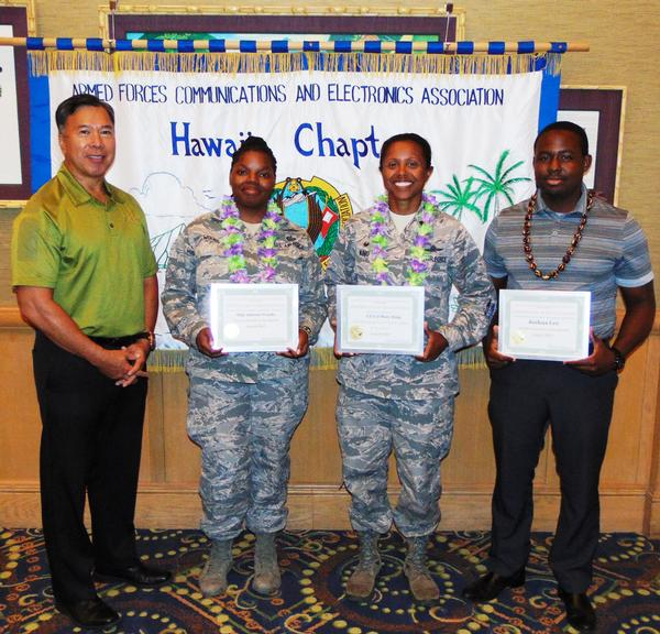 Receiving recognition from Fong at the August luncheon are (l-r) Staff Sgt. Jaleesa Woods, USAF, Young AFCEAN of the Month; Lt. Col. Mary King, USAF, Senior Government Leader; and Joseph Lee, CEO Configure LLC, AFCEAN of the Month.