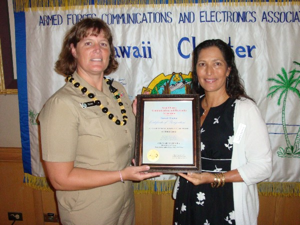 Cmdr. Marcia Ziemba, USN, chief of the IT Services Division at (J-64) Command, Control, Communications and Cyber Directorate, U.S. Pacific Command, receives the Senior Government Leader of the Month Award for October from Pacheco.