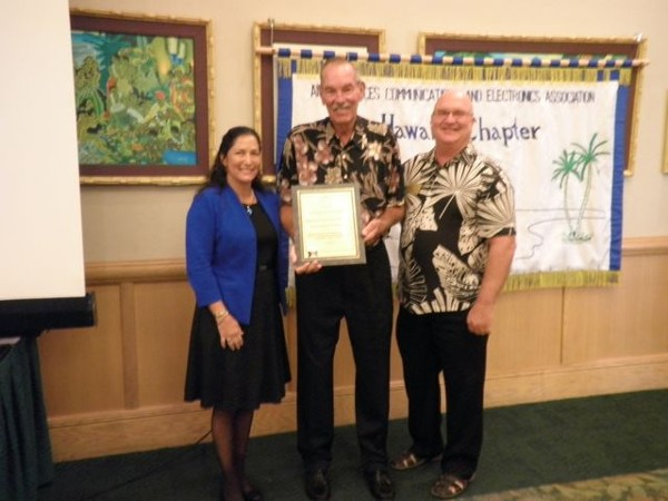 HAWAII� Adm. Dick Macke, USN, (Ret.), (c), receives the Distinguished Life Membership Award from Chapter Chairman of the Board and Past President Cynthia Pacheco and Regional Director Ed Ryglewicz (r) in June.