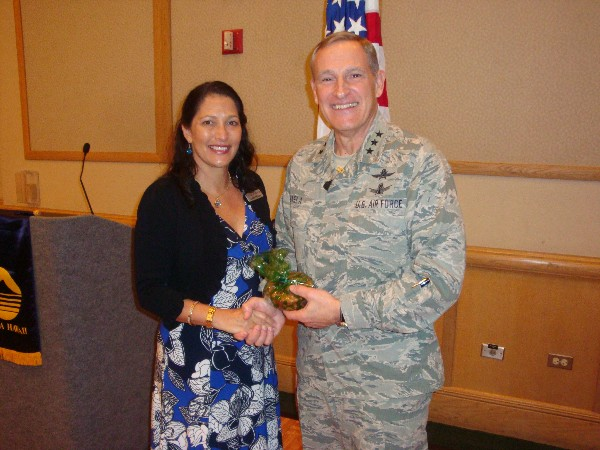 Cynthia Pacheco, chapter president, recognizes the January guest speaker Lt. Gen. Michael Basla, USAF, chief, information dominance, and chief information officer, Office of the Secretary of the Air Force.