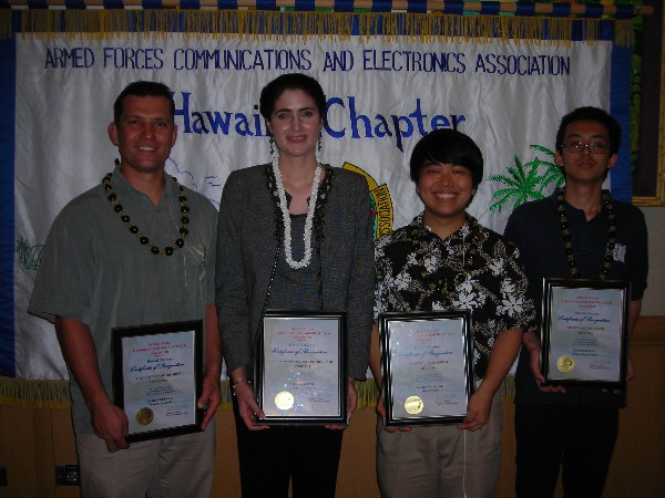 Award recipients at the April luncheon are (l-r) James Muller, HP, Young AFCEAN of the Month; Paola Saibene, State of Hawaii, Senior Government Leader of the Month; and Blake Tsuzaki of Iolani School and Stephen Mau of Mililani High School, Students of the Month.