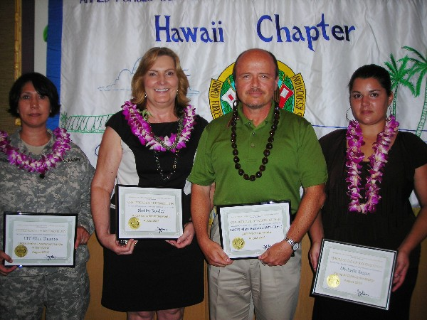 August award winners are (l-r) Lt. Col. Gina Thomas, USA, deputy G-6, 94th Army Air Missile Defense Command, Senior Government Leader of the Month; Shelley Rowley, program manager, Hawaii Medical Services Association, Executive of the Month; Lt. Cmdr. Alan Dunston, USN (Ret.), AFCEAN of the Month; and Michelle Sagan, senior consultant, Booz Allen Hamilton, Young AFCEAN of the Month.