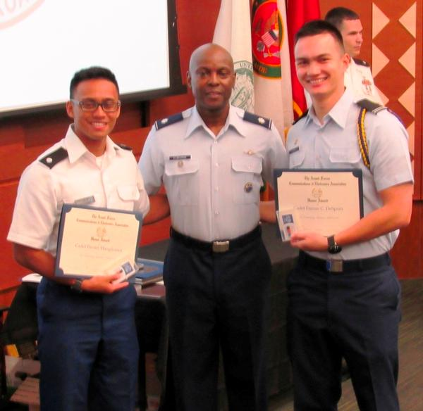 Col. Elbourne (c) congratulates Cadets Manglicmot (l) and DeSpain on their AFCEA awards during the May ceremony.