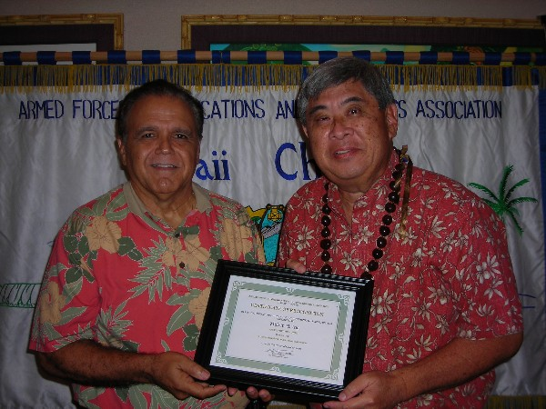 Lindo (l) recognizes the October AFCEAN of the Month, Melvin Ing, business development, CACI International.