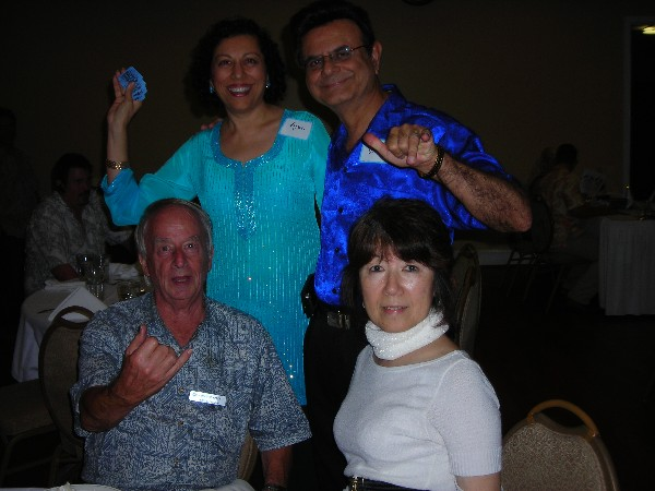 Together at the October celebration are (top row, l-r) Alka and Vino Mehta along with (bottom row) Bill and Setsuko Crawley.