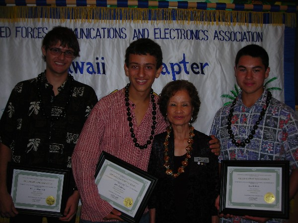 Award winners together in September are (l-r) William Trip Blaser III, Waialua High School, September Student of the Month; Sam Chalekian, Kaiser High School, August Student of the Month; Riglewicz; and Koa Knitter, St. Louis High School, September Student of the Month.