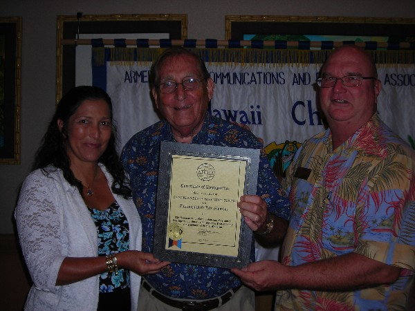 HAWAII�Chapter Chairperson Cynthia Pacheco (l) and Regional Vice President Lt. Cmdr. Ed Riglewicz, USAF (Ret.) (r) present the Distinguished Life Membership Award to Capt. Kenneth D. Wiecking, USN (Ret.) in July.