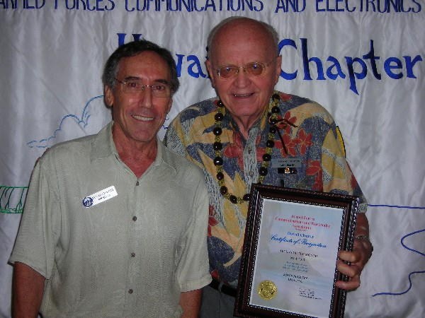Bloom (l) honors Martin, 30-Year Member and AFCEAN of the Month at the chapter's May meeting.