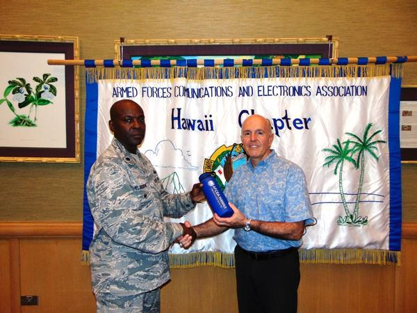 Chapter President Lt. Col. Callistus Elbourne, USAF (l), presents a token of appreciation to the chapter's May guest speaker Bryan Tepper of the Hawaiian Electric Company (HECO).