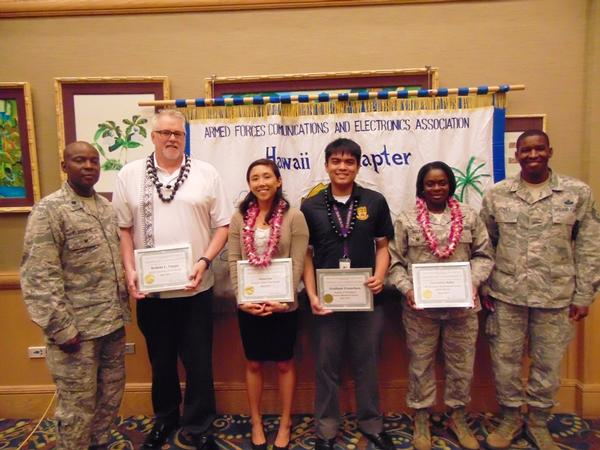 Col. Melbourne (l) honors May award winners, including (from 2nd from l) Executive of the Month Robert