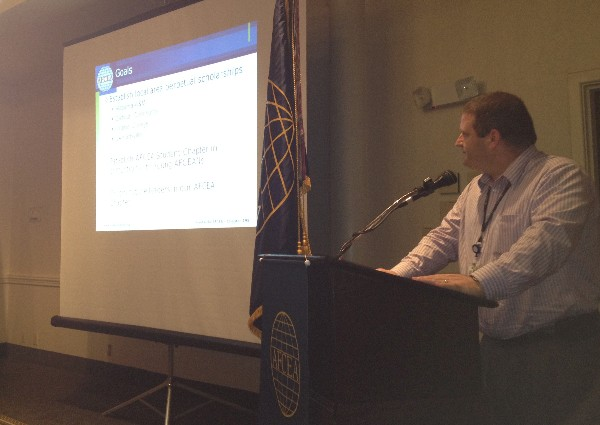 Rick Tuggle, chapter scholarship chair, presents the chapter�s new scholarship program during the September luncheon.