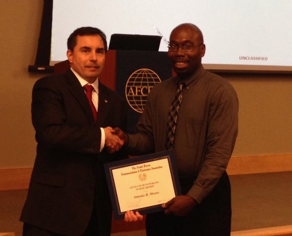Antonio Moore (r) receives a $5,000 National AFCEA Scholarship for Veterans of Iraqi Freedom and Enduring Freedom from Shaw in February.