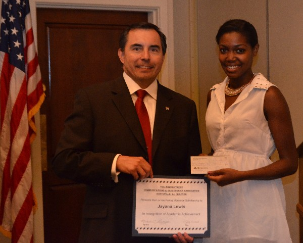 Jayana Lewis (r) is presented a $1000 scholarship by Bruce Shaw, chapter scholarship director, in July.