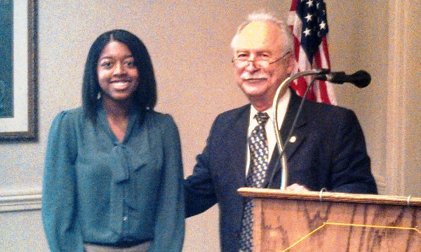 In September, Mike Schexnayder, chapter president, congratulates scholarship recipient Danielle Lewis.