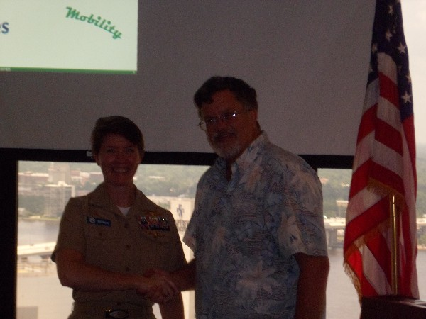 JACKSONVILLE—Capt. Bob Whitkop, USN (Ret.), chapter president, thanks Capt. Carrie Hasbrouck, USN, commander, Defense Information Systems Agency U.S. Special Operations Command, for her presentation in June.