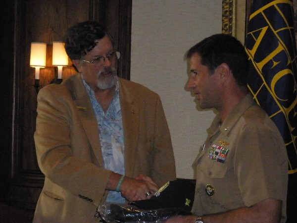 Capt. Bob Whitkop, USN (Ret.), chapter president, presents mementos to Cmdr. Keats at the January luncheon in Jacksonville, Florida.