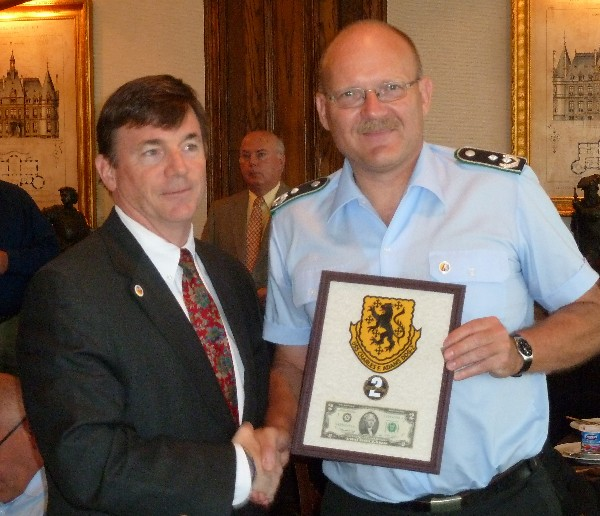 JACKSONVILLE�Capt. Dan Bean, USN, (Ret.), president of the Adams Class Museum effort in Jacksonville, presents a plaque to Lt. Col. Volker Kozok of the German Military Cyber Delegation visiting Jacksonville in June.
