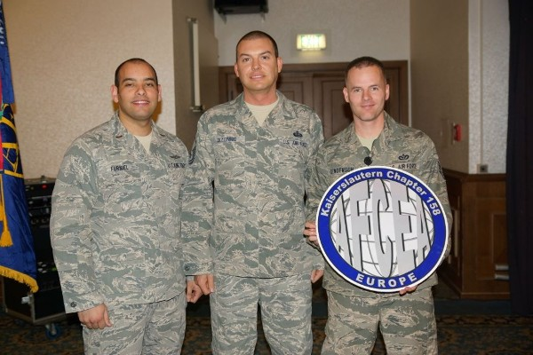 Accepting $300 continuing education scholarships in December are (l-r) 2nd Lt. Ronald Furniel, USAF; Master Sgt. John Dizonno, USAF; and Staff Sgt. Freddie Henderson, USAF.