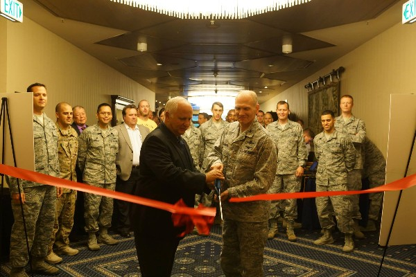 Maj. Gen. John Maluda, USAF (r), and Col. Douglas Barron, USAF (l), cut the ribbon officially opening the 2014 Ramstein Summer Technology Expo.