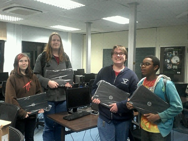 Students from the CyberPatriot team at Ramstein High School in Germany receive new laptops thanks to the support of chapter sponsor CDW-G.