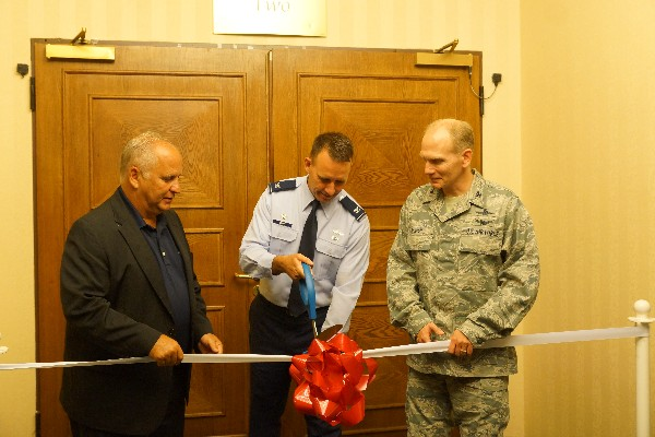 Cutting the ribbon to kick off the chapter�s summer technology expo in July are (l-r) Gen. John W. Maluda, USAF (Ret.); Col. Russell Smith, USAF, chapter president; and Col. Douglas Barron, USAF, deputy director, U.S. Air Forces in Europe � Air Forces Africa/A-6.
