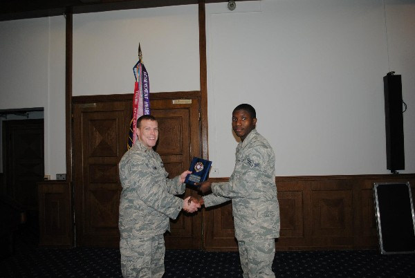 2nd Lt. Jason Loomis, USAF (l), presents the Emerging Leader Award to Airman 1st Class Michael Pirtle, USAF, during the March luncheon.