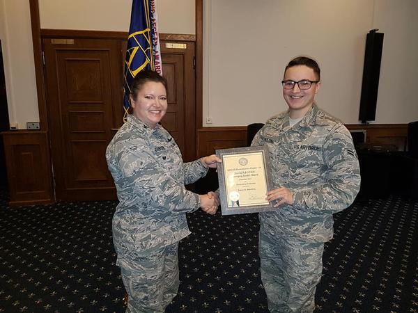 Airman 1st Class Ian Spaulding, USAF, receives the chapter's Emerging Leader Award at the December luncheon.