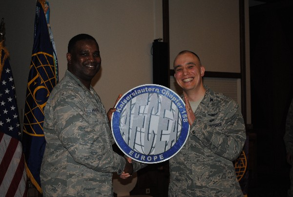 In February, Col. Kurt Gaudette, USAF (r), commander, 693 Intelligence, Surveillance, and Reconnaissance Group, receives a chapter coin from Lt. Col. Christopher D. Brooks, USAF, chapter first vice president.