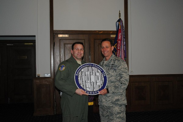 Col. Russell Smith, USAF (r), chapter president, presents a chapter coin to Brig. Gen. Thomas Sharpy, USAF, U.S. Air Forces Europe – Air Forces Africa A-5/8/9, who spoke at the March luncheon event.