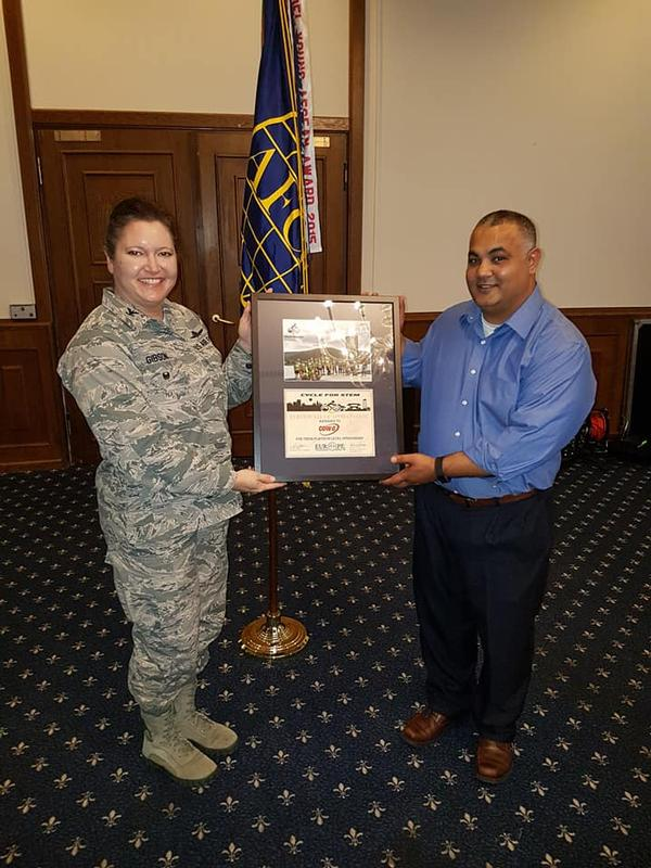 Col. Robin Gibson, USAF, chapter president, presents Rashmi Patel with a special award in December for his continued sponsorship and participation in the chapter's annual Cycle 4 STEM fundraiser.