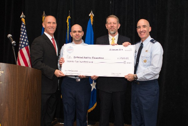 In January, Bud Vazquez (l), chapter president, and Scott Hardiman (2nd from r), board chairman, present a $2,500 check to Col. Lester Weilacher, USAF (r), base commander, and Chief Master Sgt. Gerald Nunes, USAF, for the air Force Enlisted Education Fund.