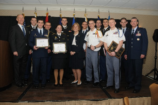 Bud Vasquez (l), chapter president; Honorable Dr. Sheila Widnall, former secretary of the air force; and Col. Scott Owens, USAF, chapter vice president for ROTC affairs, join scholarship winners at the April awards luncheon.